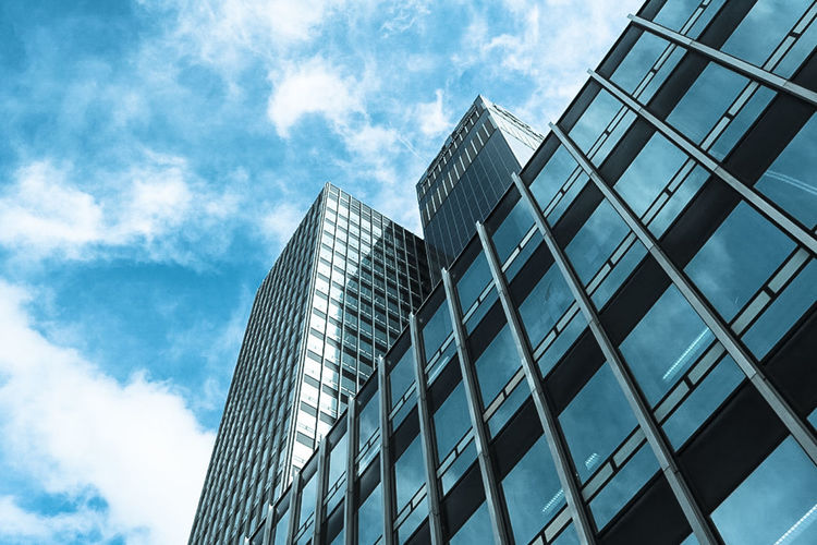 Architectural Feature Architecture Blue Building Exterior Building Story Built Structure City City Life Cloud Cloud - Sky Day Development Financial District  Growth Low Angle View Modern Office Building Outdoors Repetition Sky Skyscraper Tall Tall - High Tower Urban Skyline