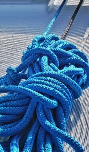 High angle view of blue tied ropes on boat