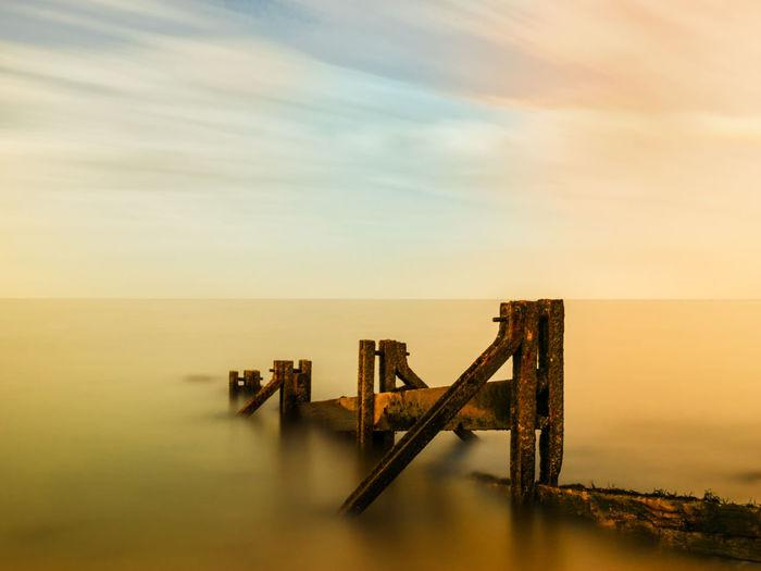 Scenic View Built Structure In Calm Sea