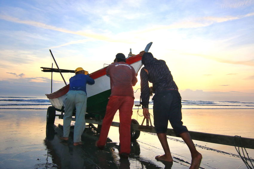 Sunrise Fisherman Boat Fishermen's Life Fishermanvillage Sea Fisherman Fishing Sky Beach Water Outdoors Men Adult Only Men People Adults Only