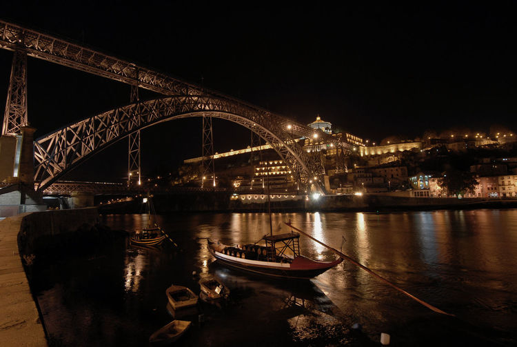 Illuminated City Night Lights Portugal Ancient Boat Architecture Boat Bridge - Man Made Structure Built Structure City Connection Illuminated Nautical Vessel Night No People Outdoors River Suggestive Photography Transportation Water