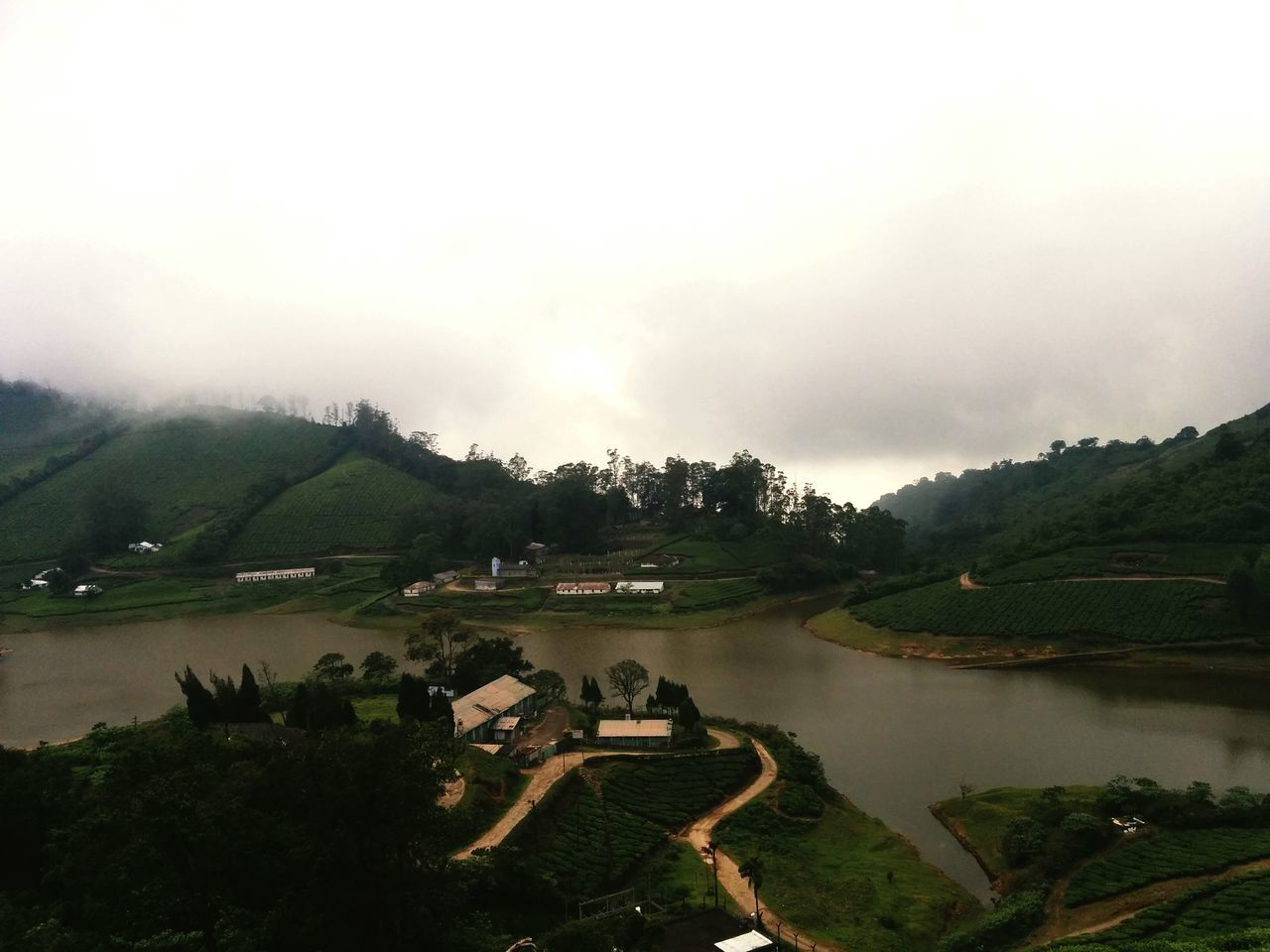 water, mountain, lake, nature, scenics, outdoors, no people, tree, beauty in nature, fog, tranquility, sky, landscape, day, architecture