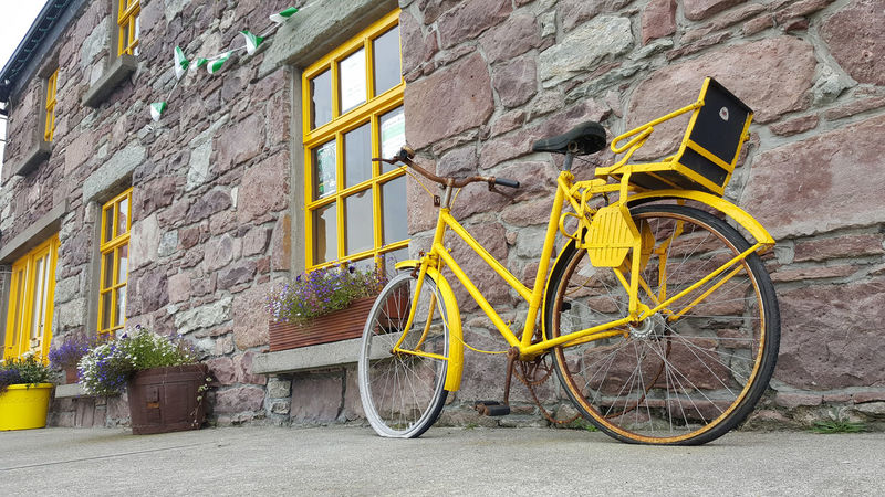 Paint The Town Yellow Bicycle Building Exterior Flat Tyre Mode Of Transport No People Stationary Yellow