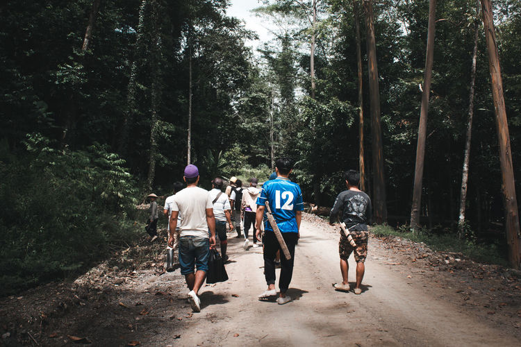 The Still Life Photographer - 2018 EyeEm Awards The Street Photographer - 2018 EyeEm Awards Adventure Day Forest Full Length Group Group Of People Growth Land Leisure Activity Lifestyles Men Nature Outdoors People Plant Real People Rear View Togetherness Tree Walking