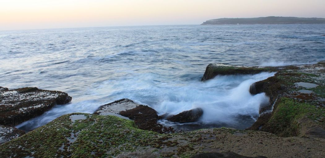 Waves at sunrise Pink Sky Beauty In Nature Day Horizon Over Water Motion Nature No People Outdoors Rock - Object Scenics Sea Sky Sunrise Water Wave