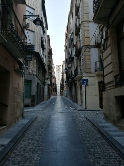 Alcoy Architecture City Built Structure Building Exterior The Way Forward Outdoors Sky Day No People Clock Handmade Antique Single Object Cityscape Mountain Range Illuminated Social Issues Urban Skyline Igniting Travel Destinations Alcoy Urban Road Cold Temperature Mountain Peak Cloud - Sky