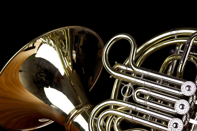 Music Instrument French Horn, French horn Isolated on black Musical Instrument Music Metal Arts Culture And Entertainment Brass Instrument  Studio Shot No People Indoors  Brass Black Background Close-up Musical Equipment Gold Colored Trumpet Wind Instrument Shiny Reflection Still Life Classical Music Jazz Music Steel Chrome Silver Colored