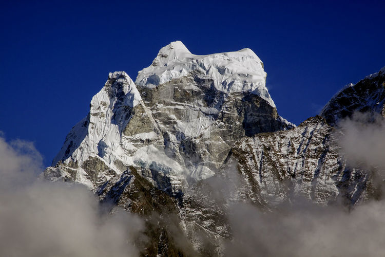 Scenic view of snowcapped kangtega in nepal  against clear blue sky