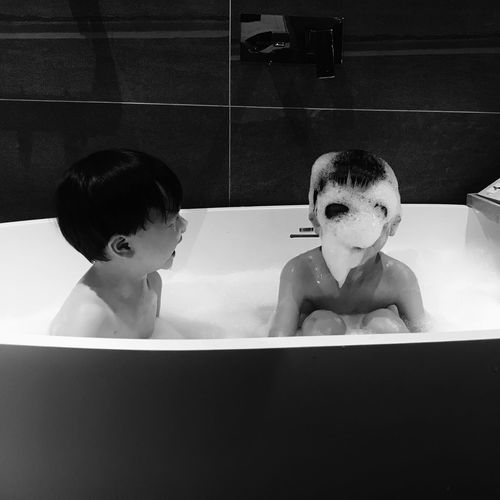 Bathtub Taking A Bath Childhood Washing Lifestyles Happiness Boys Black And White Indoors  Relaxation Portrait