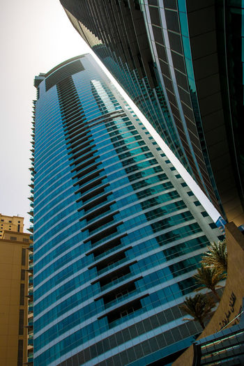 Marina Dubai Architecture Built Structure Building Exterior Building Office Building Exterior Modern Office City Glass - Material Low Angle View Reflection No People Day Skyscraper Tall - High Window Outdoors Nature Sky Tower Glass Financial District
