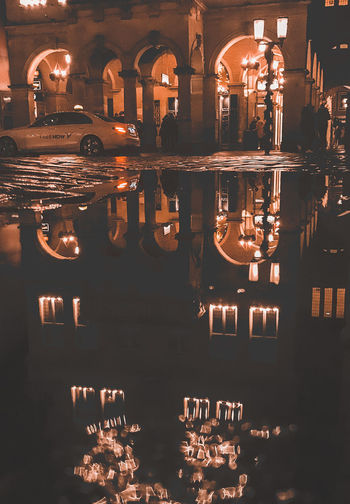 Reflection of illuminated lights in glass at night