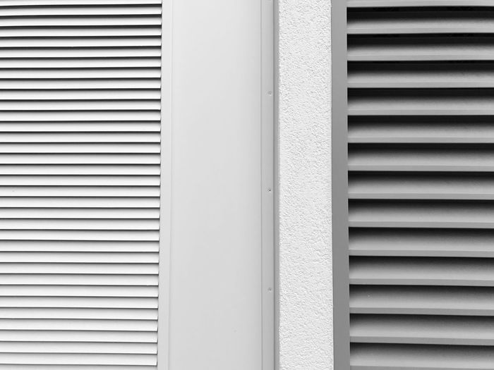 Close-up of window blinds and shutter