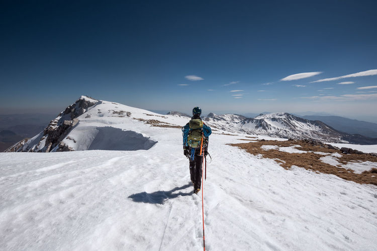 HIKING Cold Temperature Adventure Mountain Range Sky Winter Sport Mountain Sport One Person Leisure Activity Snow Day Snowcapped Mountain Winter Scenics - Nature Full Length Warm Clothing Outdoors Ski-wear Beauty In Nature Men Real People Activity Extreme Sports Mountian View Mountain Peak Trekking Trekker Hiking Blue Sky Lifestyles Summit Alps Alpinism Climbing Climbing A Mountain Walking Mountain View Snow Covered Nature Outdoor Photography Trip Outside Outdoor Play Equipment Man Rope Climbing Rope Portrait Behind Cloud - Sky Clouds My Best Photo The Great Outdoors - 2019 EyeEm Awards