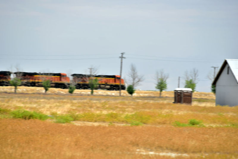 Train Passes Thru Allensworth 4 Allenworth, Ca. Lt. Colonel Allen Allensworth Founded Town 1908 BNSF Railway Freight Railroad Train Engines Motion Blur Train_lovers Train Photography Burlington Northern & Santa Fe Railway Merged 1996 Owned By Berkshire Hathaway Inc 2nd Largest Freight Railroad In North America Intermodal Freight & Bulk Cargo Rural Scene Farming Community Grassy Field Power Lines Landscape_Collection Landscape_photography Landscape Built Structures Barns Huts
