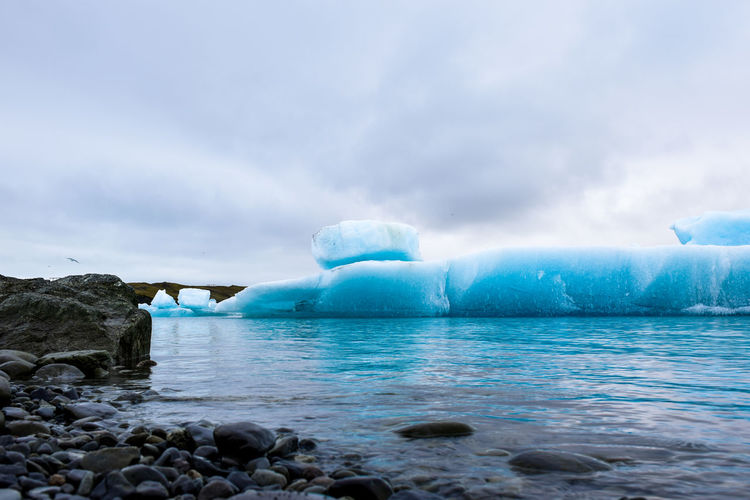 Jökulsárlón Glacier Lagoon Astrology Sign Beauty Beauty In Nature Blue Cloud - Sky Cold Temperature Day Floating On Water Ice Iceland Landscape Nature No People Outdoors Polar Climate Rock - Object Scenics Sea Sky Tranquil Scene Tranquility Water