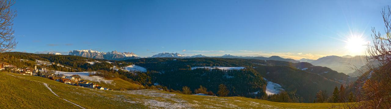 ritten and the dolomites Beautiful Nature Dolomites Panorama Ritten Trees Winter Landscape Blue Sky And Sunset Cold Temperature Forest Landscape Meadow Mountains And Sky Panoramic Landscape Renon South Tirol Sunny Day Village