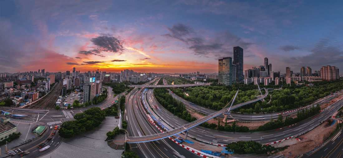 Singil District, Seoul, South Korea skyline at night. Architecture Bridge - Man Made Structure Building Building Exterior Built Structure City City Life Cityscape Cloud - Sky High Angle View Landscape Modern Multiple Lane Highway Nature No People Office Building Exterior Outdoors Residential District Road Sky Skyscraper Street Sunset Tall - High Transportation