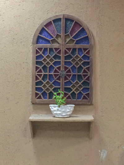 Arch Architecture Building Building Exterior Built Structure Closed Day Floral Pattern Flower Pot Flowering Plant Glass Glass - Material Nature No People Outdoors Pattern Plant Potted Plant Wall Wall - Building Feature Window Window Frame Window Sill
