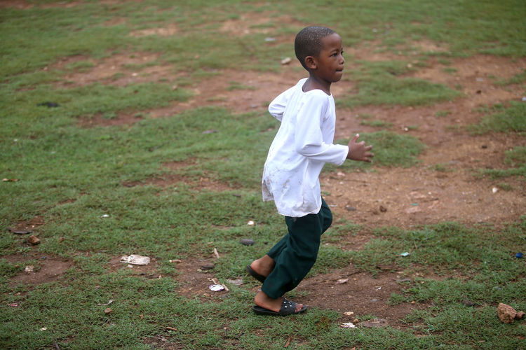 Full length of boy standing on field