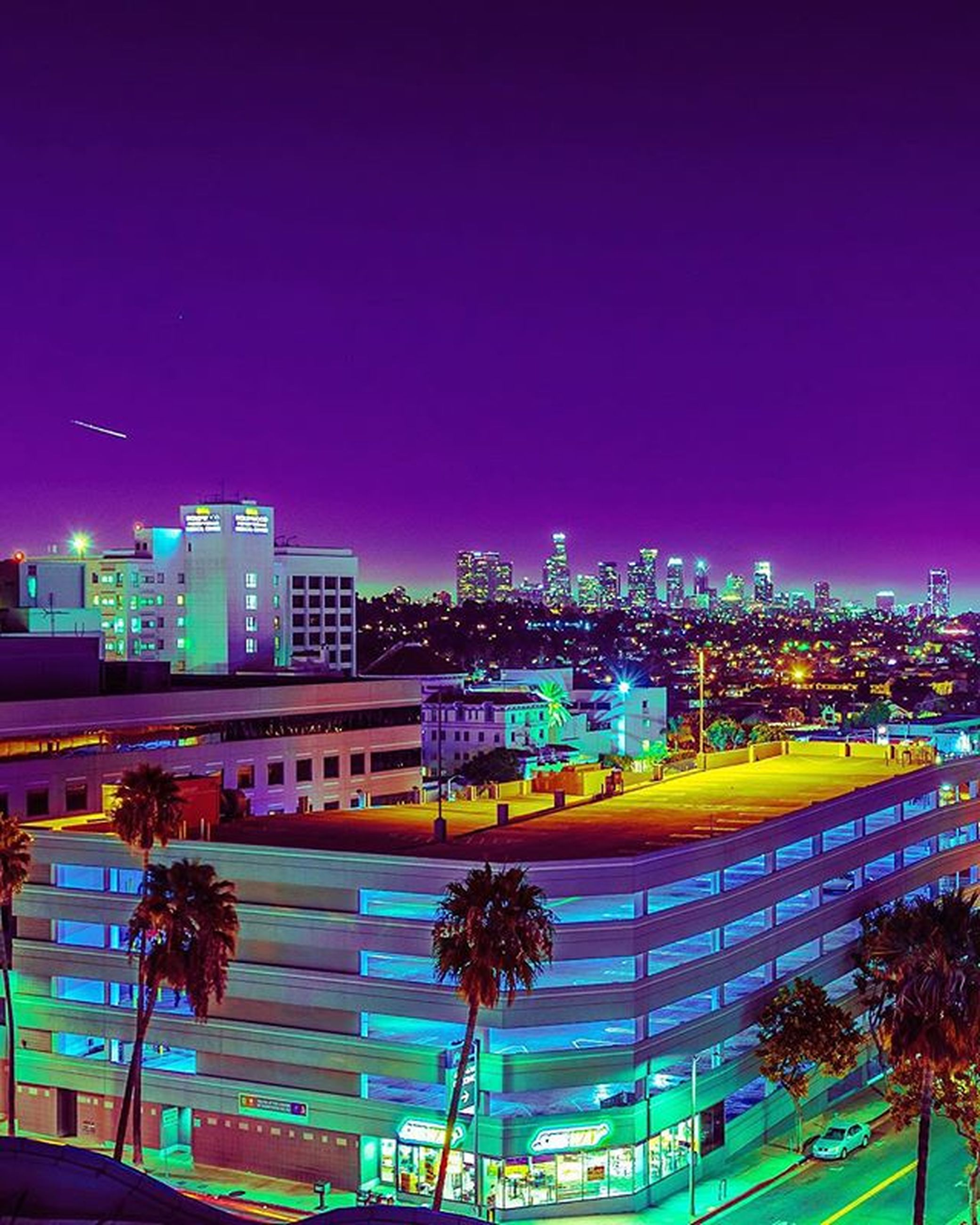 illuminated, night, building exterior, architecture, built structure, city, clear sky, blue, copy space, cityscape, modern, sky, outdoors, city life, skyscraper, lighting equipment, light - natural phenomenon, no people, multi colored, long exposure