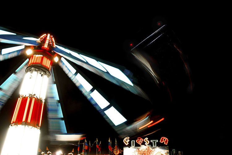 Night Illuminated Architecture Lighting Equipment Low Angle View Built Structure Long Exposure Group Of People Blurred Motion Motion Lifestyles Real People Building Exterior City People Light Women Men Multi Colored Nightlife