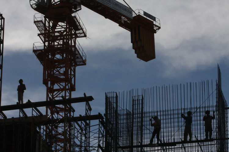 Low angle view of people on construction site
