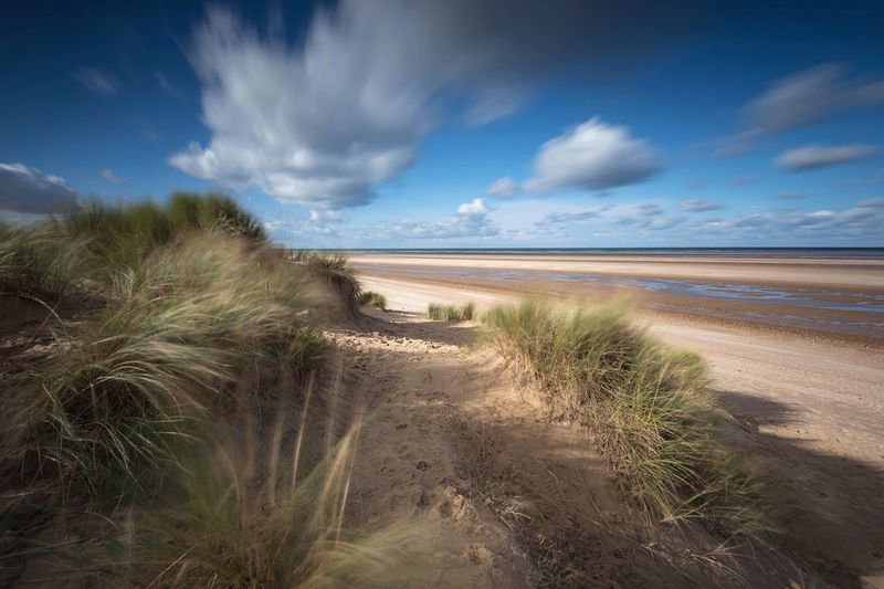 Dunes Scenics Beauty In Nature Sand Dune Wells-next-the-Sea Norfolk Seascape Seaside Beach Tranquil Scene Cloud - Sky Long Exposure Tranquility Blue Sky Sea And Sky Beach Life Landscape Beauty In Nature Sea Sky Outdoors Secluded Beach Secluded  No People The Great Outdoors - 2017 EyeEm Awards