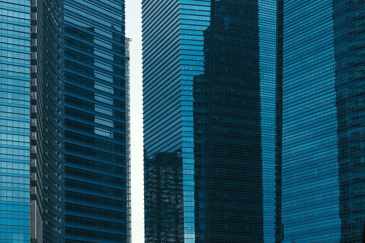 Skyscrapers glass wall detail Modern Architecture Shape The Architect - 2018 EyeEm Awards Architecture Blue Building Building Exterior Built Structure City City Building Detail Glass - Material Modern Office Office Building Exterior Pattern Skyscraper Tall - High Texture