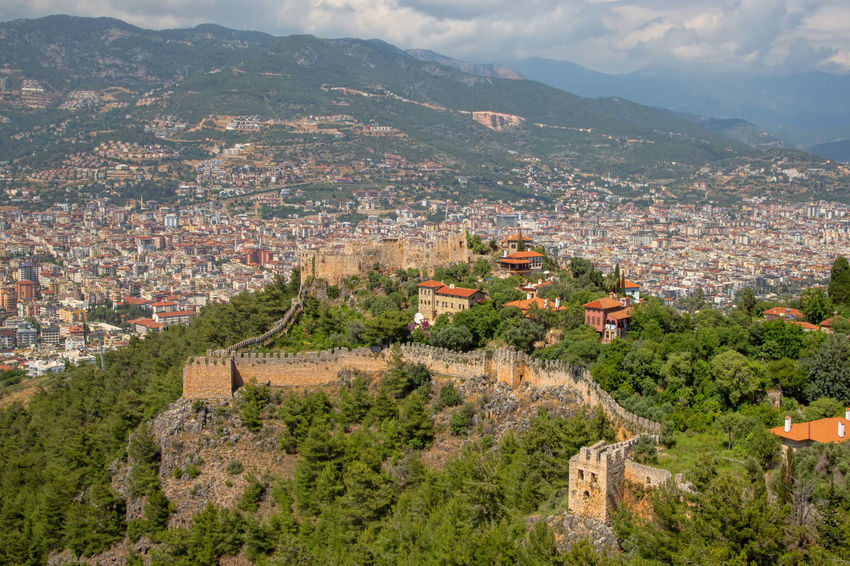 Alanya Castle View Alanya Castle Turkey Alanya Castle Architecture Building Building Exterior Built Structure City Cityscape Cloud - Sky Community Environment Fortress Fortress Wall High Angle View Landscape Mountain Mountain Range Nature Plant Scenics - Nature Stone TOWNSCAPE Tree