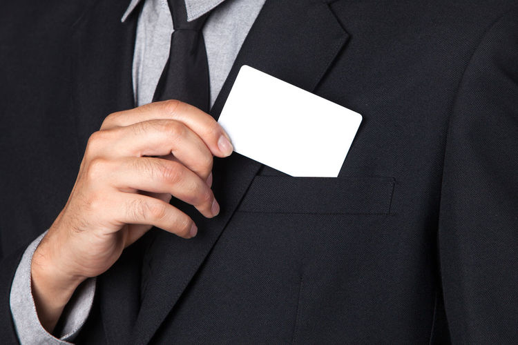 Close-Up Of Man Holding Business Card