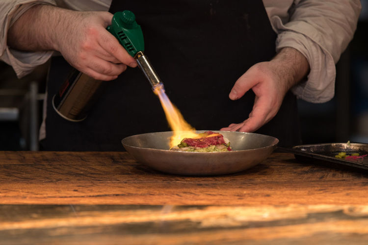 Gorynich restaurant in Moscow Cooking Chef Restaurant Food Fire Kitchen Food And Drink Holding Preparation  Indoors  Midsection One Person Table Real People Kitchen Utensil Human Hand Men Bowl Freshness Hand Lifestyles Wood - Material Household Equipment Preparing Food Mixing