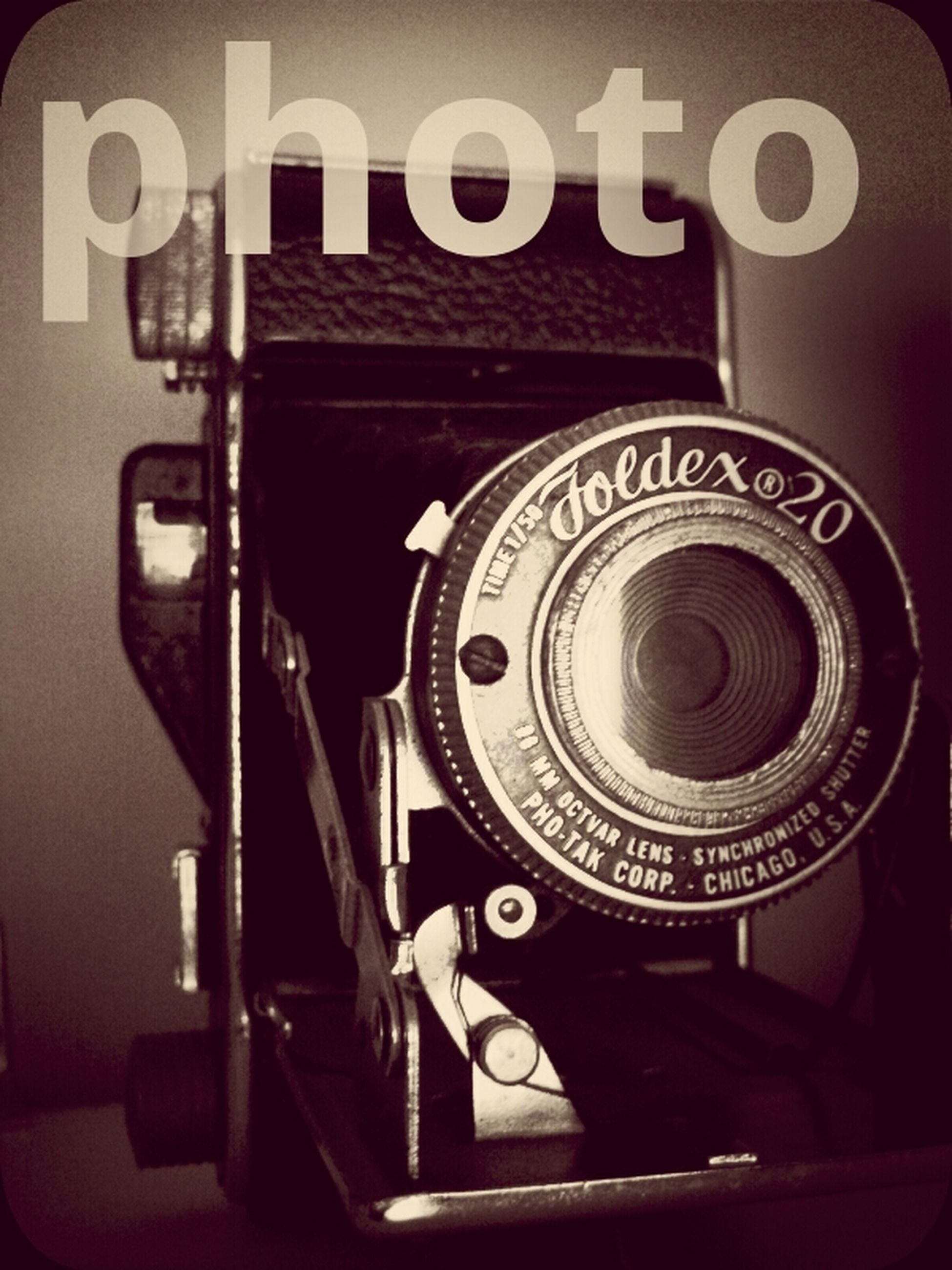 indoors, technology, photography themes, camera - photographic equipment, close-up, old-fashioned, communication, retro styled, music, photographing, wireless technology, arts culture and entertainment, machinery, connection, digital camera, musical instrument, equipment, focus on foreground, time, lens - optical instrument