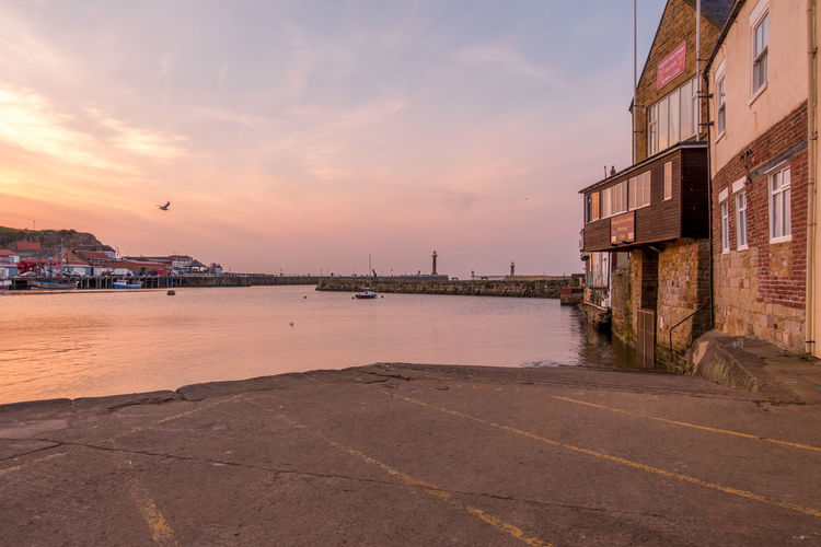 Whitby Whitby Harbour Whitby View Whitby North Yorkshire Architecture Sky Water Building Exterior Built Structure Sunset Cloud - Sky Building City Nature No People Transportation Outdoors Sea Waterfront Nautical Vessel Orange Color Mode Of Transportation