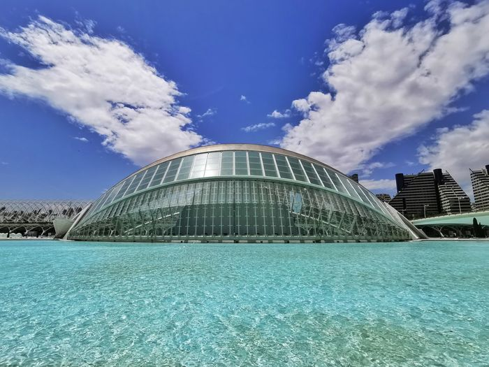 View of swimming pool in city against sky