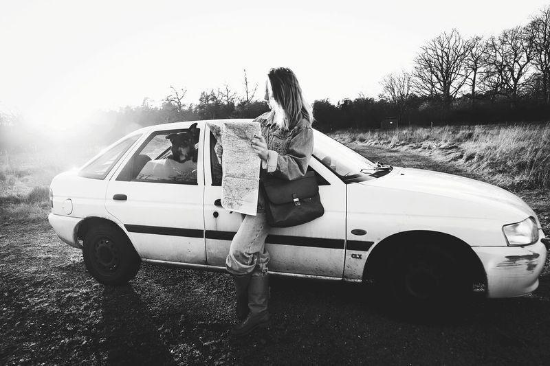 Woman in car on field
