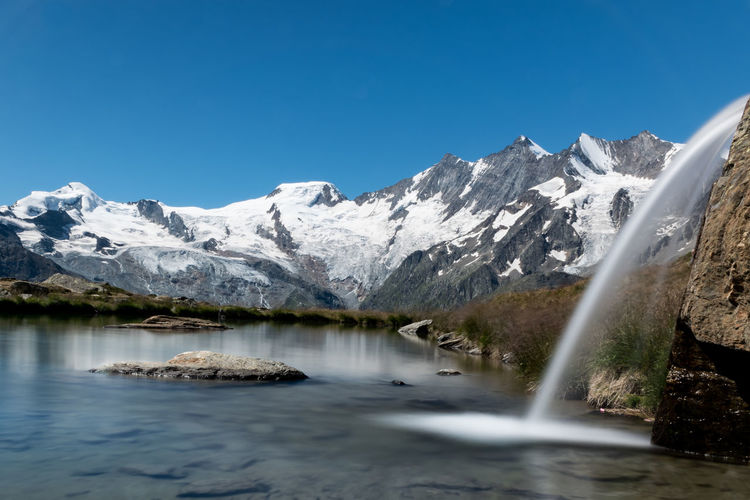 Water Tranquil Scene Scenics Beauty In Nature Clear Sky Cold Temperature Snow Snowcapped Mountain Mountain Range Majestic Tranquility Nature Switzerland Mountain Swiss Alpine Mountain Peak Rocks Lake Pond Waterfall Nd Long Exposure Big Stopper
