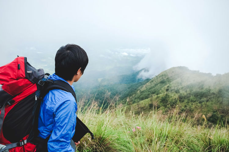 Side view of backpacker on mountain