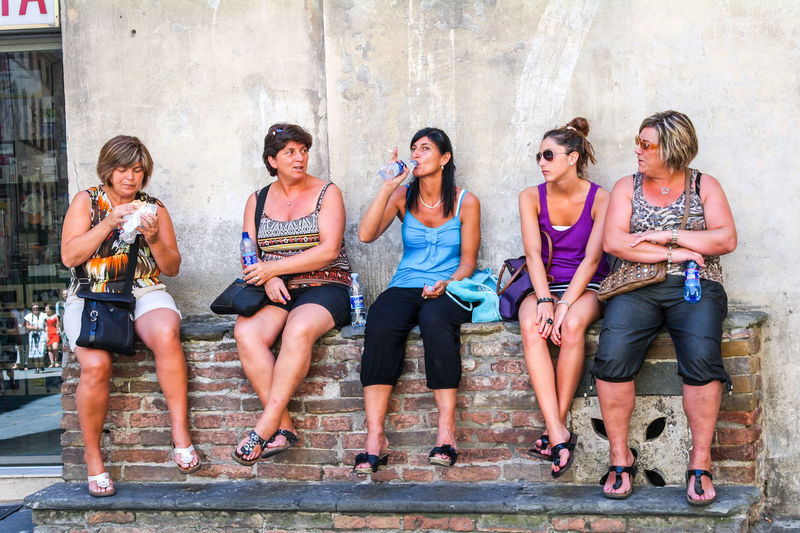 Group of women resting in the shade on hot summer's day in Siena. Relaxing Adult Attitude Casual Clothing City Cool Attitude Fashion Friendship Front View Full Length Individuality Outdoors People Quenching My Thirst  Sitting Standing Out From The Crowd Togetherness Women Young Women The Week On EyeEm