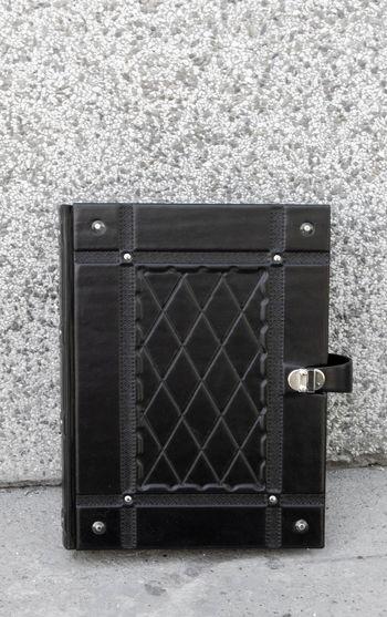 Close-up of metal box against brick wall
