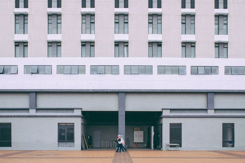 Man in front of building