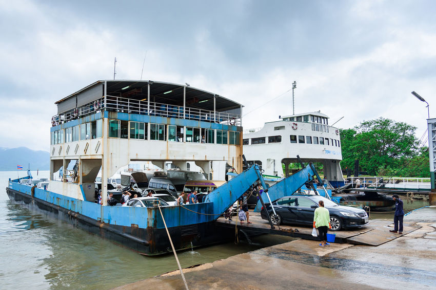 Trat, Thailand - May, 20, 2017 : Unidentified name Tourists are driving out of the ferry boat at Ao Thammachart Pier quay from Koh Chang on Trat Thailand. Architecture Building Exterior Built Structure Cloud - Sky Day Editorial  Ferry Ferry Boat Illustrative Illustrative Editorial Mode Of Transport Moored Nature Nautical Vessel No People Outdoors Sky Thailand Transportation