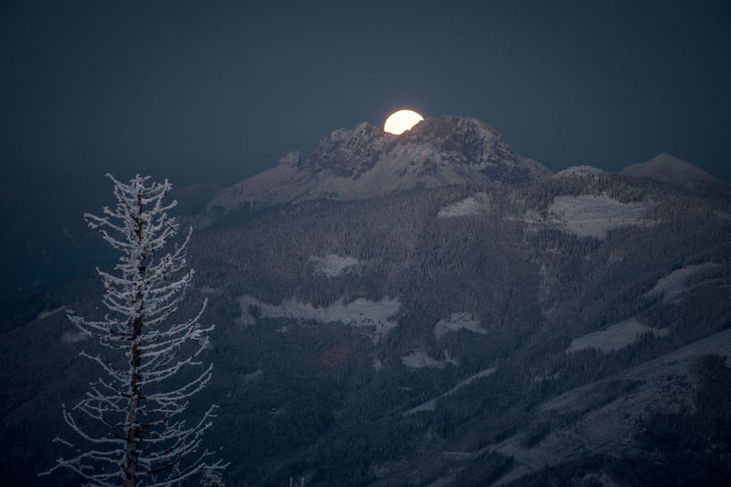 Super moon behind a mountain Mountain Night Scenics - Nature Beauty In Nature Sky Nature Tranquility Tranquil Scene No People Environment Moon Landscape Non-urban Scene Snow Winter Mountain Range Cold Temperature Land Full Moon Outdoors Astronomy Snowcapped Mountain Moonlight Mountain Peak