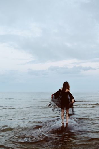 Sea One Person Real People Water Standing Sky Horizon Over Water Beach Full Length Rear View Cloud - Sky Nature Leisure Activity Lifestyles Beauty In Nature Day Scenics Ankle Deep In Water Outdoors Young Adult The Week Of Eyeem Breathing Space Ocean