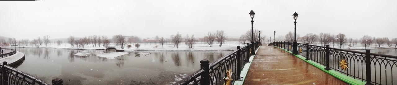 Panoramic View Of Frozen Canal Against Clear Sky
