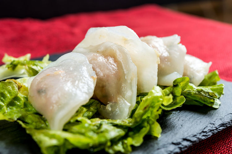 Close-up of dumplings on slate at table