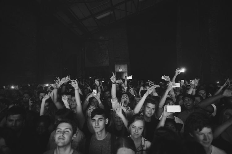 Crowd With Mobile Phones At Music Festival