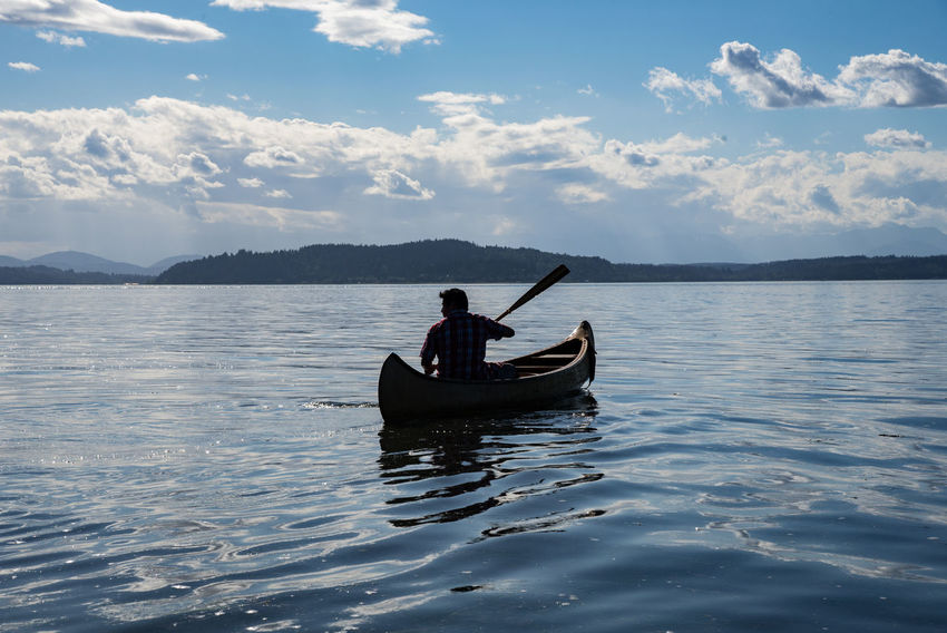 Canoeing in Puget Sound Beauty In Nature Boat Canoe Cloud - Sky Leisure Activity Lifestyles Mode Of Transport Nature Nautical Vessel Outdoors Paddle Rippled Sailing Scenics Silhouette Sky Tourism Tranquility Transportation Water Waterfront