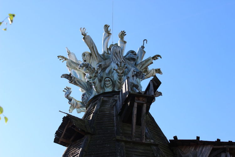 Freizeitpark Ghosts Angel Architecture Art And Craft Blue Building Exterior Built Structure Clear Sky Creativity Day Geister History Human Representation Low Angle View Male Likeness Nature No People Ornate Representation Sculpture Sky Statue The Past Travel Destinations