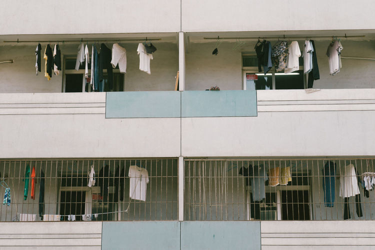 Low angle view of laundry drying in balcony