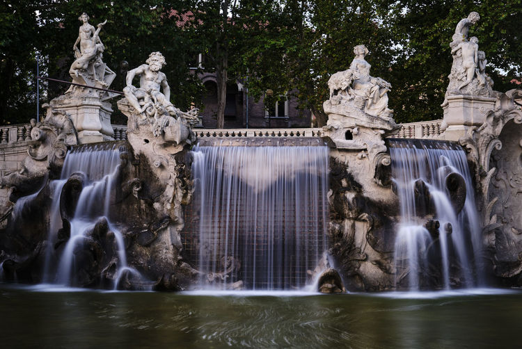 View of fountain against lake